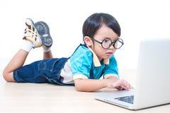 Boy using laptop computer Stock Image