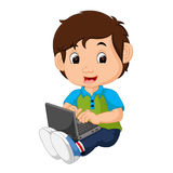 Boy using laptop Stock Photography