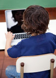 Boy Using Laptop In Kindergarten Royalty Free Stock Photo