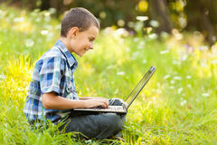 Boy using laptop outdoor Royalty Free Stock Photo