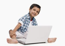 Boy using a laptop Royalty Free Stock Image