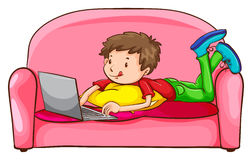 A boy using a laptop at the sofa Stock Photos