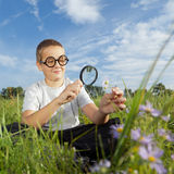 Boy using Magnifying Glass Royalty Free Stock Photo