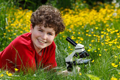 Boy using microscope outdoor Royalty Free Stock Images