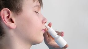 Boy using nasal spray and smiling stock video