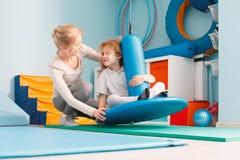 Boy using sensory integration equipment Stock Image