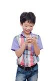 Boy using smart phone over white Stock Photos