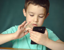 Boy is using smartphone Stock Photo
