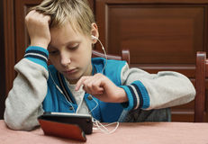 Boy is using a smartphone at home Royalty Free Stock Photo