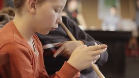 Boy using smartphone in pub. Snooker room background. Children have fun with the phone before playing billiards stock footage