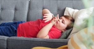 Boy using smartwatch in living room 4k. Boy using smartwatch in living room at home 4k stock video