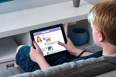 Boy Using Social Networking Site On Digital Tablet Royalty Free Stock Images