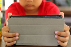 The boy using a tablet. Royalty Free Stock Photography