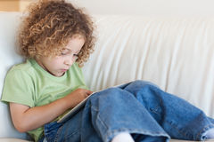 Boy using a tablet computer Royalty Free Stock Photo