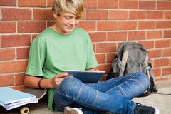 Boy using tablet computer Stock Image