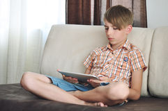 Boy using a tablet computer Stock Image