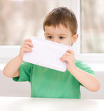 Boy using tablet. Happy little boy using tablet Stock Photos