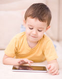 Boy using tablet. Happy little boy using tablet Royalty Free Stock Photo