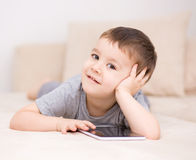 Boy using tablet. Happy little boy using tablet Stock Photography