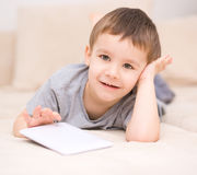 Boy using tablet. Happy little boy using tablet Stock Photo