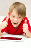 Boy using tablet Stock Photo