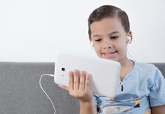 Boy using tablet Stock Images