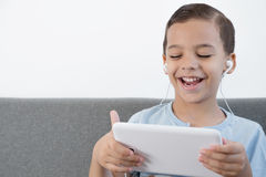 Boy using tablet Stock Image