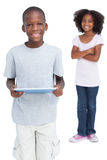 Boy using tablet pc with his sister Royalty Free Stock Image