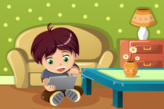 Boy using a tablet PC royalty free stock image