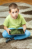 Boy using a tablet Royalty Free Stock Photo