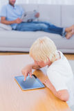 Boy using tablet at table in the living room Royalty Free Stock Images