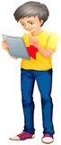 A boy using a touch screen gadget Royalty Free Stock Photos