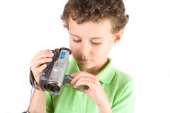 Boy using video camera Royalty Free Stock Photos