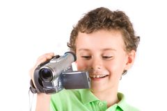 Boy using video camera Royalty Free Stock Images
