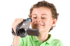 Boy using video camera Stock Images