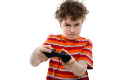 Boy using video game controller. Isolated on white background Stock Image