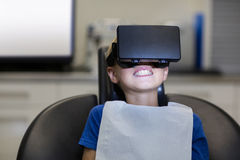 Boy using virtual reality headset during a dental visit Royalty Free Stock Photography