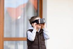 Boy using VR virtual reality goggles Royalty Free Stock Image