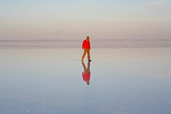 Boy on the Uyuni salt lake Royalty Free Stock Photo