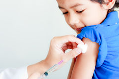 Boy and vaccine syringe stock photo