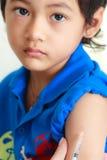 Boy and vaccine syringe Stock Photos