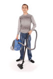 Boy with vacuum cleaner Stock Images