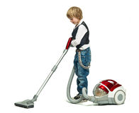 Boy with vacuum cleaner Royalty Free Stock Photography