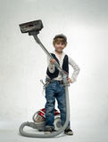Boy with vacuum cleaner Stock Photography