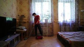 Boy Vacuuming Apartment stock footage