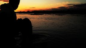 Boy valley sunset stock photos