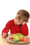 Boy and vegetables stock images