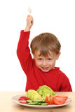 Boy and vegetables royalty free stock image
