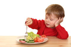 Boy and vegetables Stock Image