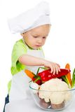 Boy with vegetables Royalty Free Stock Photo